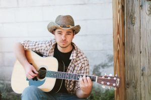 Colton Kise with acoustic guitar